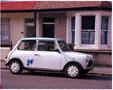 colour photo Mini outside house