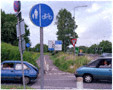 colour photo blue cars and road signs
