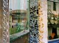 two colour photos colourful railings and mosiac wall