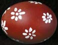 Red painted egg with white flowers