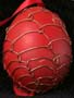 Red painted egg with wire