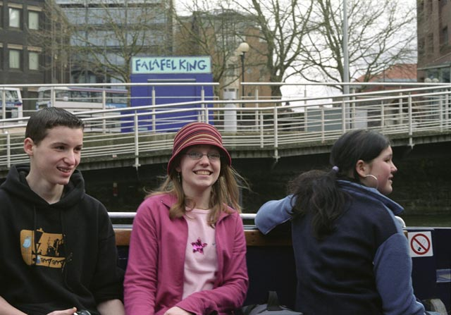 bristol UK Britain england south west pictures city photograph architecture buildings Europe young youth exchange visit holiday knowle west media project escola de bagium Linford, Terri-Ann & Sarah (left to right) about to leave the docks on a ferryboat Young people getting on board the ferry.